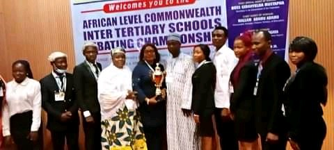 The winning team from Peaceland College Enugu and organizers of the debate during the competition at