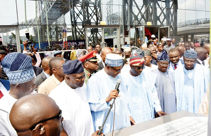 President Buhari (third left) inaugurating projects in Lagos Wednesday
