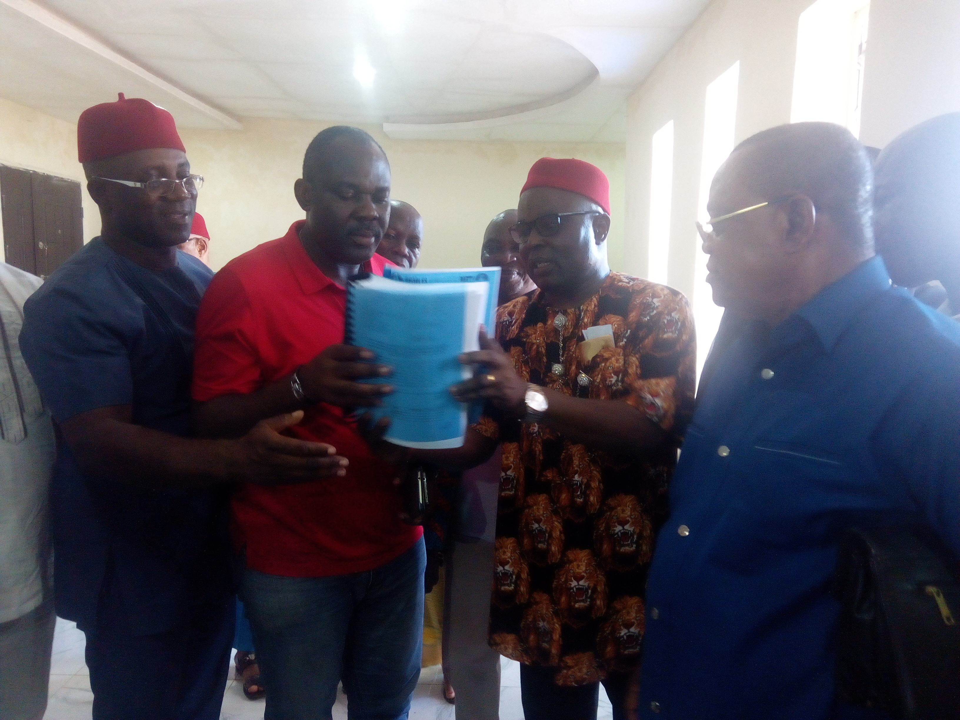 South East PDP Zonal Chairman, Austin Umahi presenting  list of Anambra Executive to Nwobu