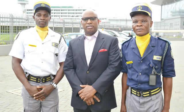 L-R: Supervisor, Halogen Security Company Limited, Francis Emepueaku; GMD,, Mr Wale Olaoye; and Mr A