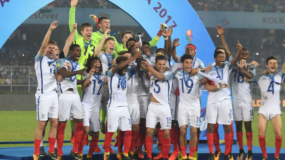 England's players celebrate with their trophy after their astonishing comeback