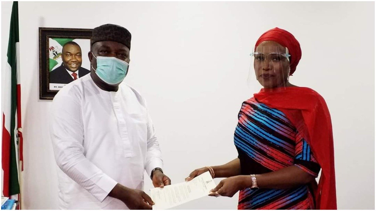 Gov. Ifeanyi Ugwuanyi and    Mrs. Ginika Florence Tor, Commissioner representing Enugu State in FCC
