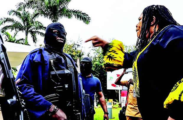 Rep. Boma Goodhead (PDP, Rivers) shouting at masked DSS operatives during the siege