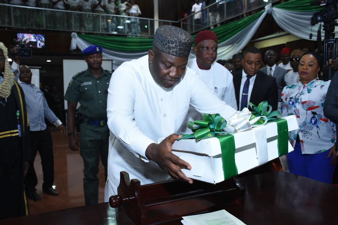Governor Ifeanyi Ugwuanyi of Enugu State presenting copies of the state's  2018 budget in the chambe